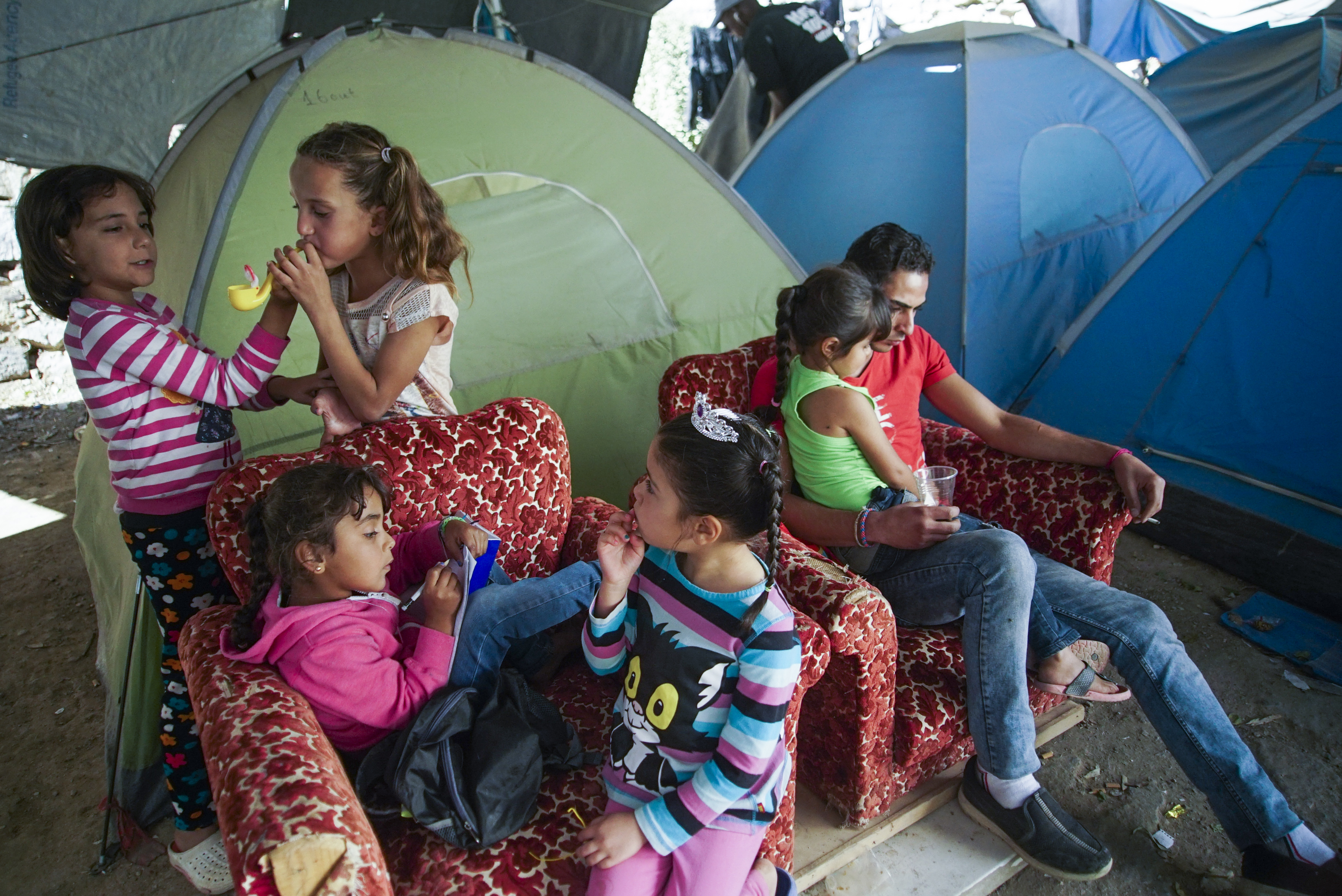 Underaged inhabitants of tent seashore camp near Vial refugee camp. Chios, Grece, Aegean Sea. 27 September, 2016.jpg